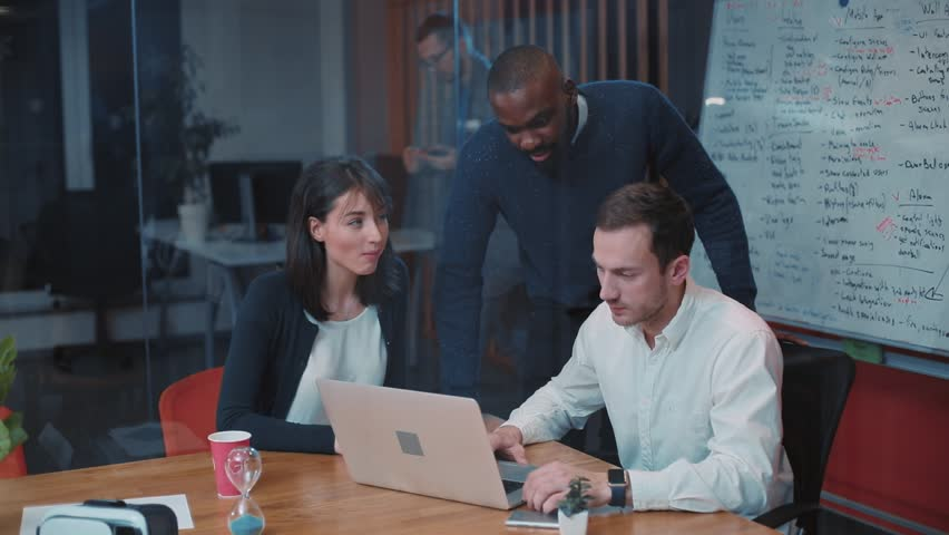 Three employees of popular international company discussing new project in modern office. One of employees showing prepared video presentation. Young chief clapping and showing thumbs up. | Shutterstock HD Video #34937545