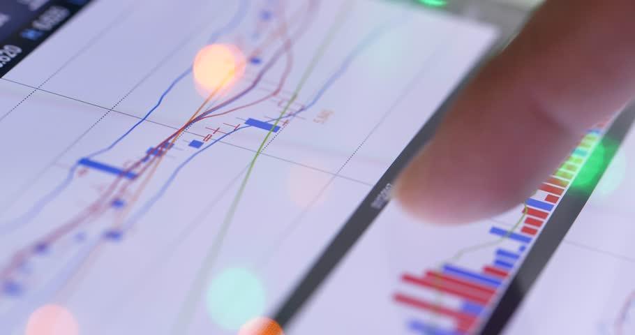 Online stock markets digit on tablet computer | Shutterstock HD Video #34946521