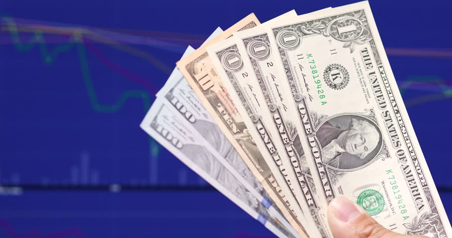 USD banknote over stock market screen background | Shutterstock HD Video #34946752