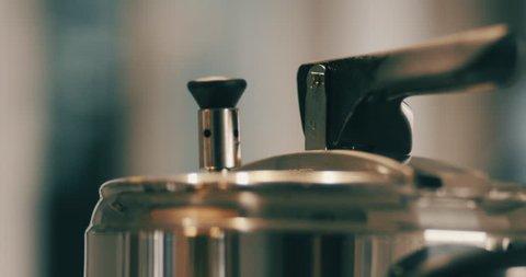 slow motion shot of pressure cooker