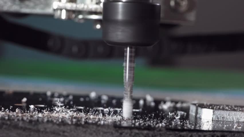 CNC milling machine proceccing plastic detail.. #34977904