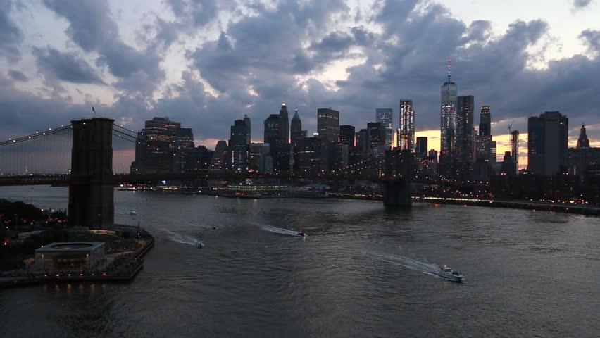 Boats navigating on the East River in New York city with the Manhattan downtown district and the Brooklyn bridge in the background at sunset, USA   Shutterstock HD Video #34985230
