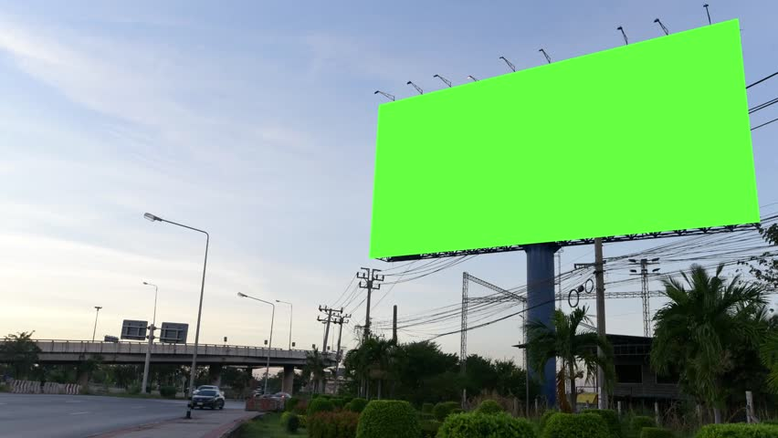Time Lapse of Blank Billboard with a Green Screen at evening  #34985764