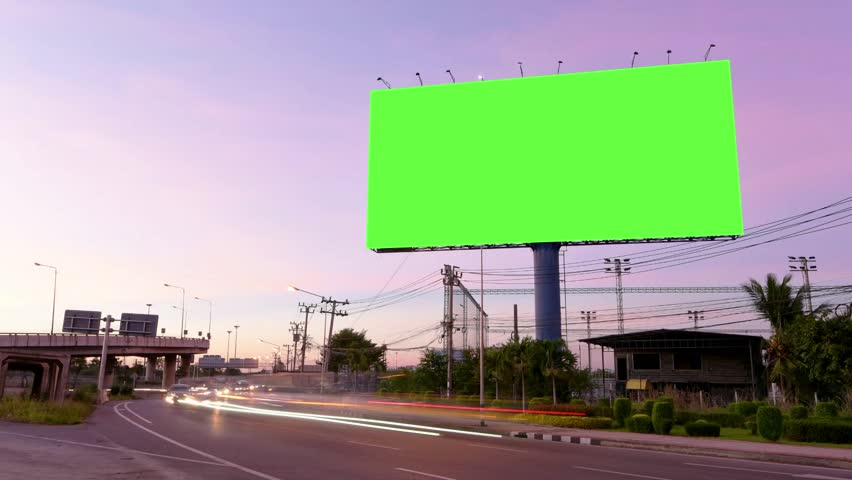 Time Lapse of Blank Billboard with a Green Screen on Night Street with light trails. #34985884