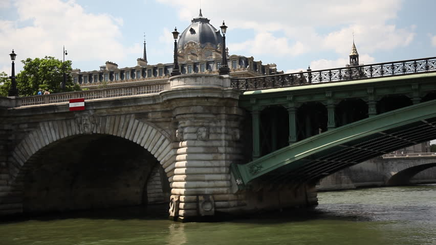 FRANCE, PARIS - JUNE 2013. Riverboat riding on the Seine river in Paris under Pont Notre-Dame | Shutterstock HD Video #34990774