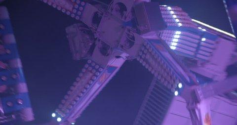 Amusement park machine slowmotion 4K by night