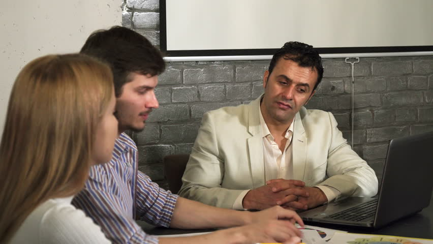 Mature hispanic businessman meeting with his younger colleagues | Shutterstock HD Video #35024401