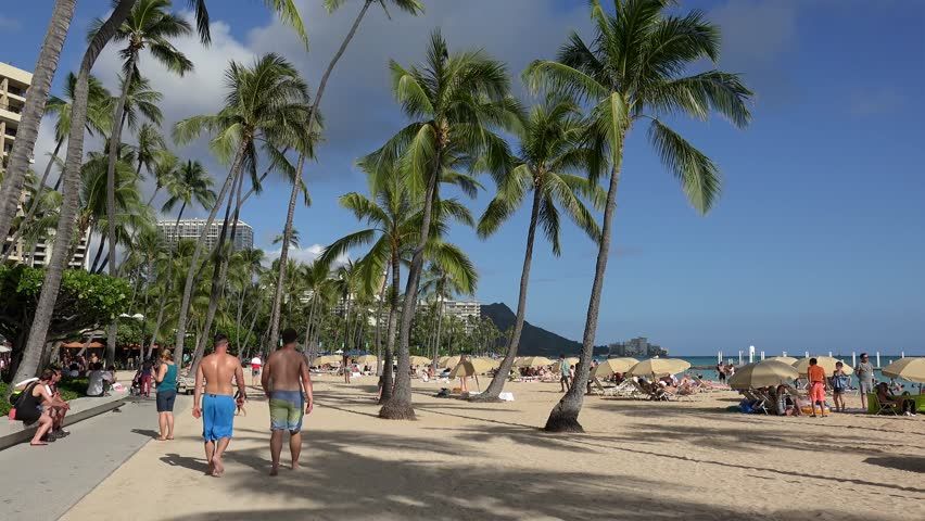 Honolulu, - MAY 12: Holidaymakers on Waikiki beach.  May 12, 2017 in Honolulu, Oahu, Hawaii, USA