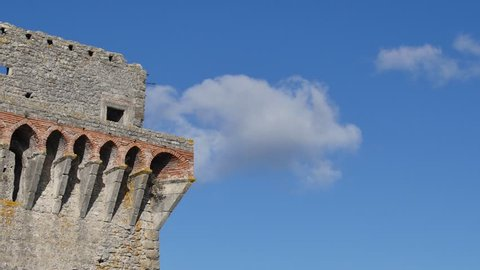 Architectonic details of the Medieval tower of the Ourem Castle in Portugal with the clouds moving