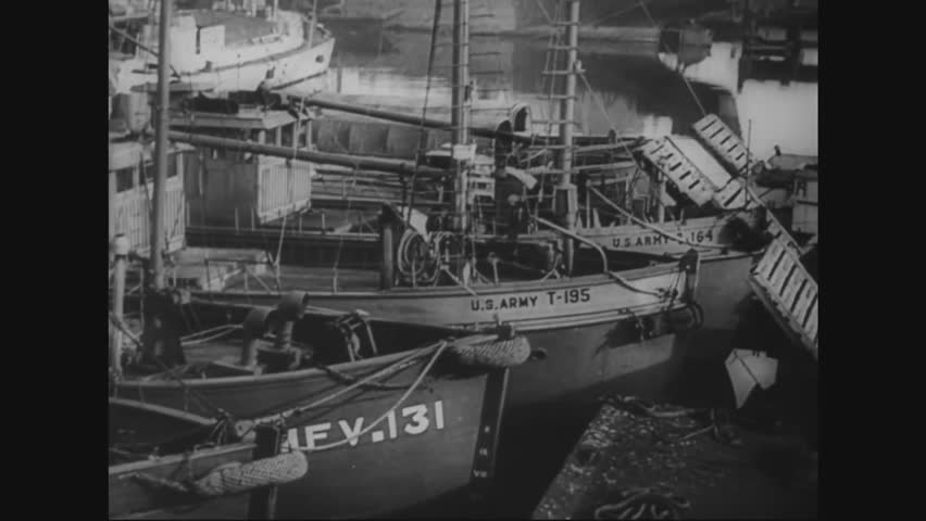 CIRCA - 1944 - Assault boats are prepared for D-Day.