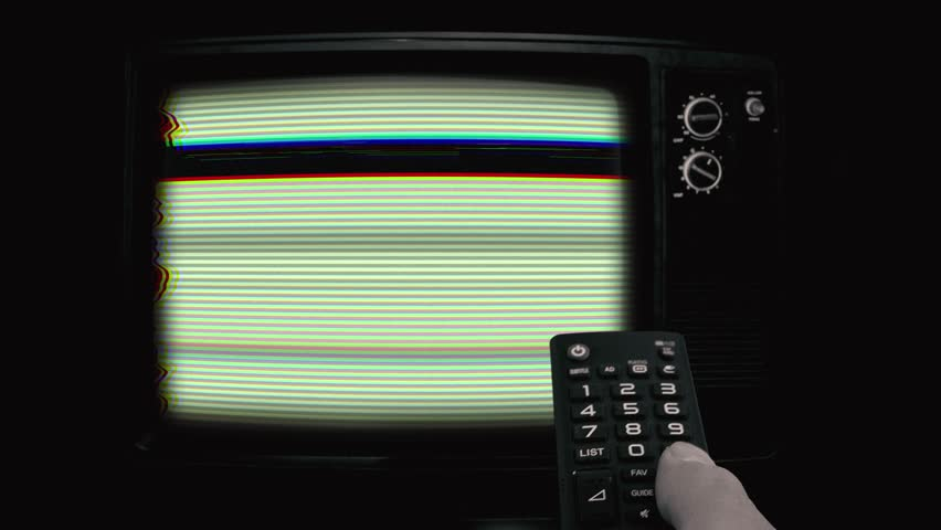 Changing Channels Tv Remote Old Television Green Screen. Male hand using a remote control to change Tv channels on a old television vintage style. Green Screen footage