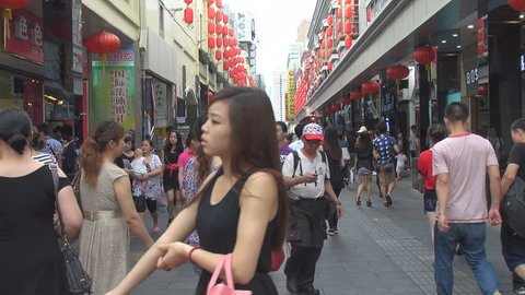 SHENZHEN, CHINA - MAY 5, 2012, Tourists visit Shopping District