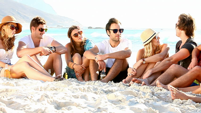 Young Hipster People Enjoying A Beach Party With Guitar Music