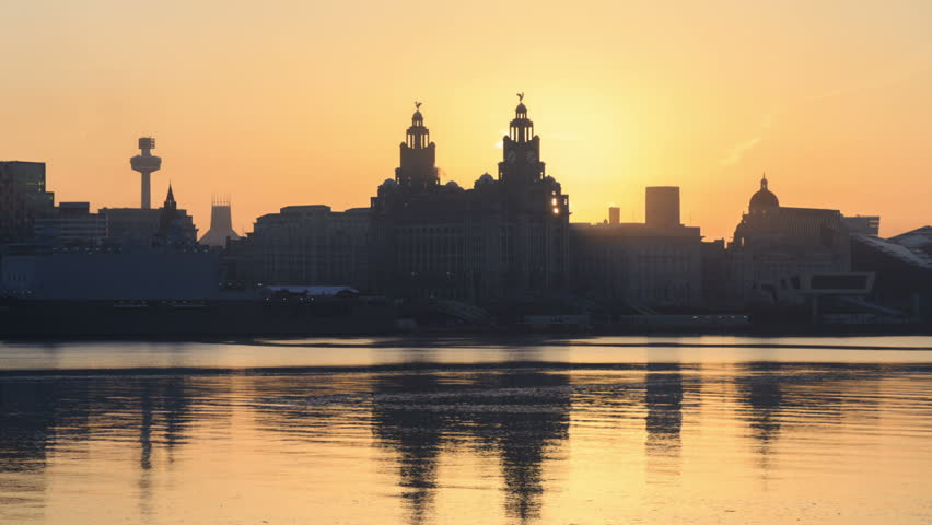 Timelapse slow zoom of sunrise over Liverpool Liver Building