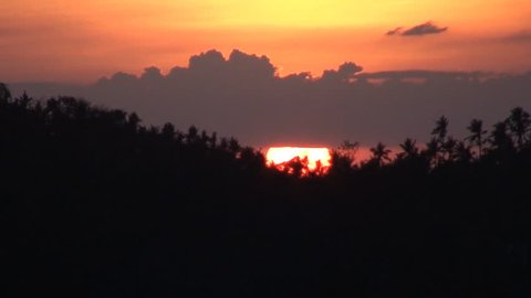 Vivid sunset over high mountains at Oriental Mindoro in Philippines time lapse