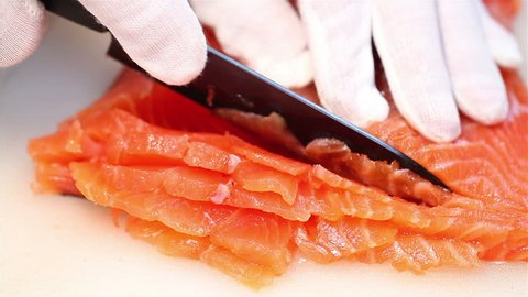 Slicing salmon fillets