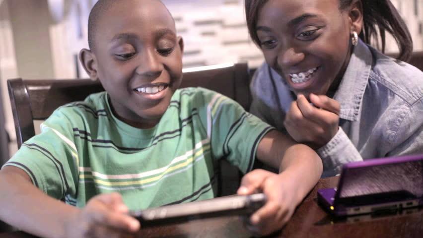 Black kids playing video games
