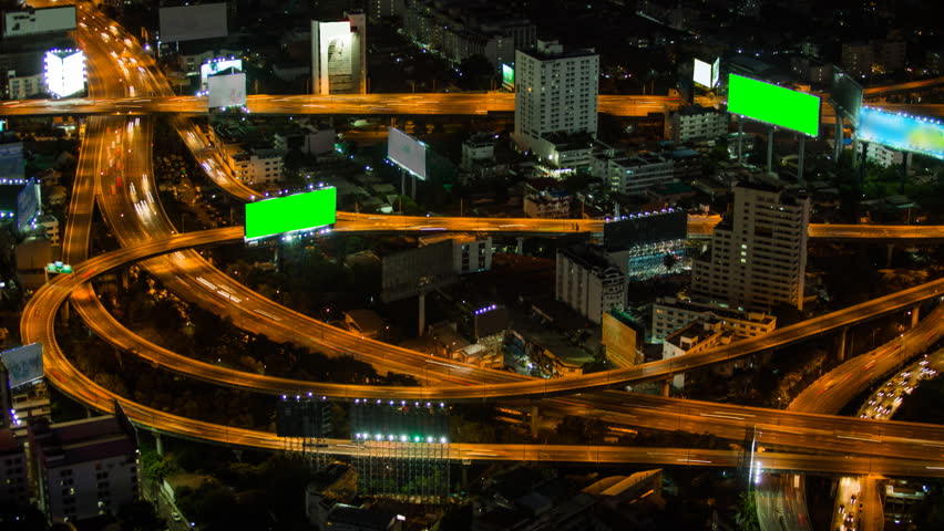 Aerial view of highway at night with green screen billboard,Time-lapse