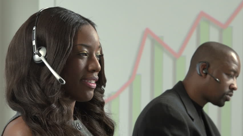 African American business woman taking a sales call using a headset | Shutterstock HD Video #3573113