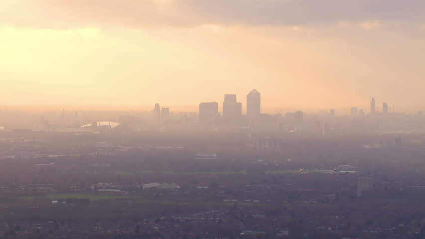 Panoramic aerial shot and cloudscape featuring the London skyline on a hazy autumn morning