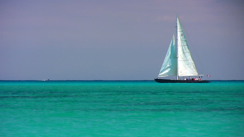 A sailboat on the horizon in the beautiful Caribbean ocean