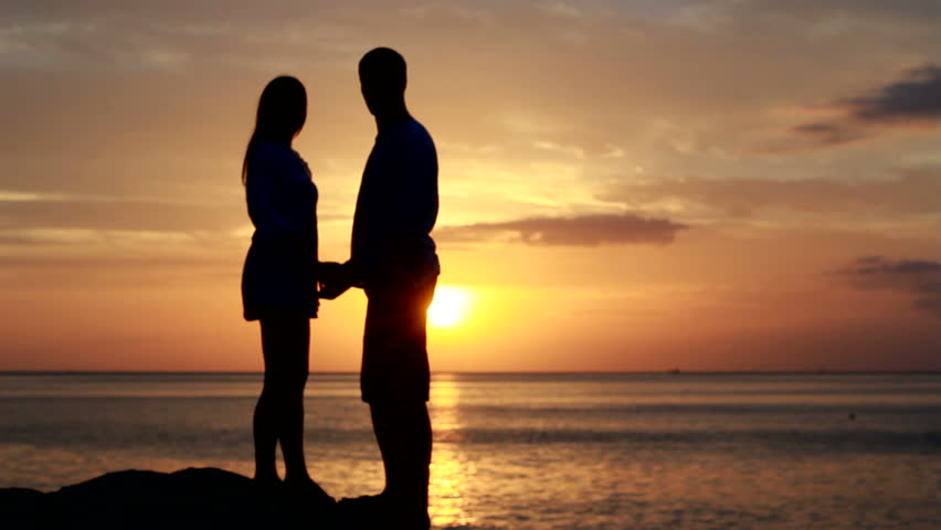 Romantic Silhouette Of Man Getting Down On His Knee And Proposing To Woman On Beach -5495
