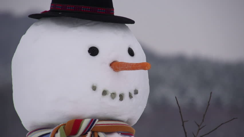 Girl building a snowman