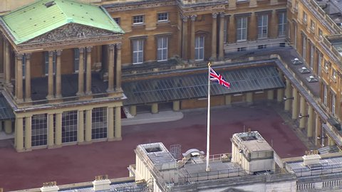LONDON - NOVEMBER 2012: Aerial view over Buckingham palace, London and the surrounding area. The union flag is being flown to signify that the queen is not in residence. London, UK. 22 November 2012