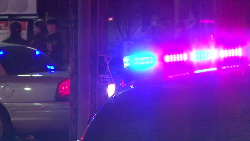 PORTLAND OREGON, CIRCA 2013: Police lights flashing at night downtown at crime