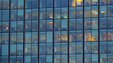 Glass business building in London at night