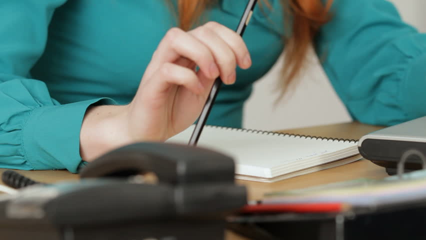 Girl is working with documents,writing something in the notebook,then goes away. | Shutterstock HD Video #3640235