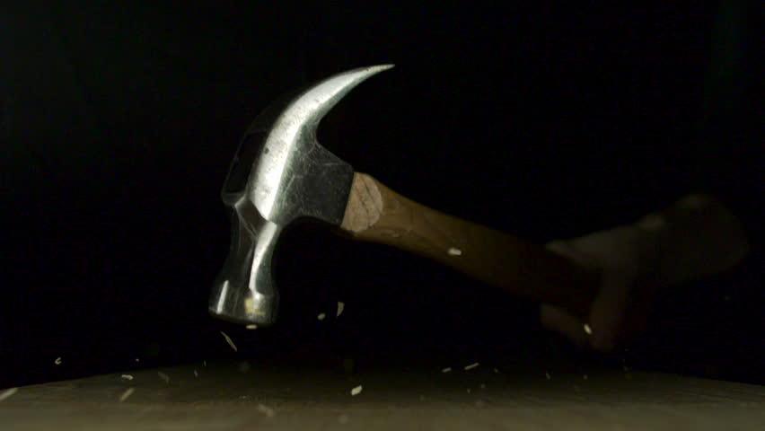 Hammering nail on wood panel shooting with high speed camera, phantom flex.