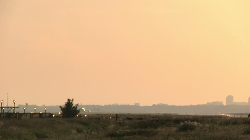 Huge plane landing at dusk