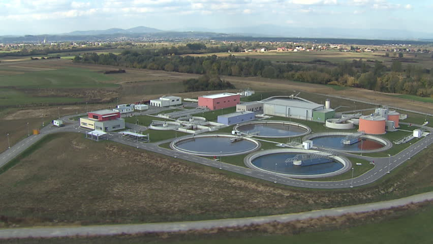 View from above on a Wastewater treatment plant. Aerial helicopter shot.