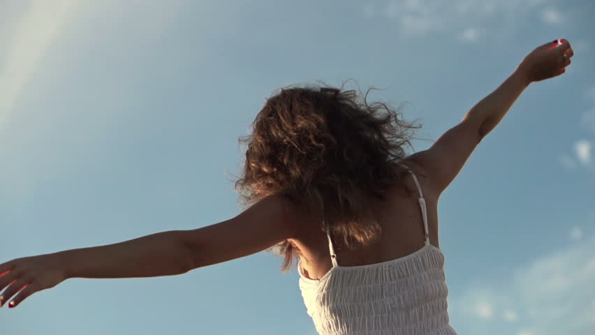 Happy woman dancing outdoors, super slow motion, shot at 240fps