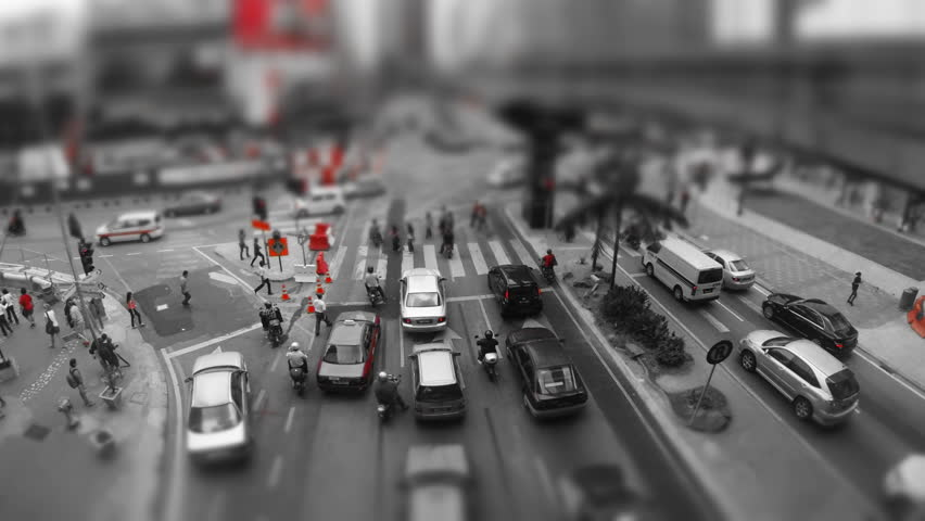 KUALA Lumpur, 21 March:  (Color Graded) tilt shift time lapse vertical pan of the traffic on Jalan Bukit Bintang in Kuala Lumpur Malaysia on 21 March 2013