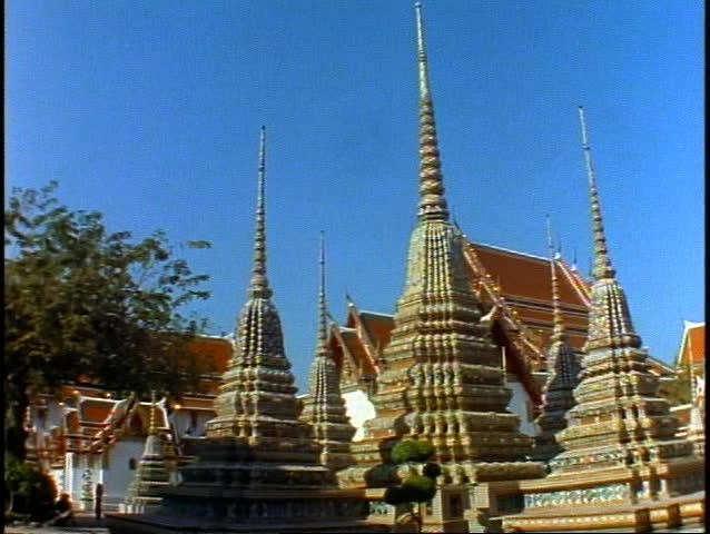 Temple of the Reclining Buddha, wide shot spires, pan right