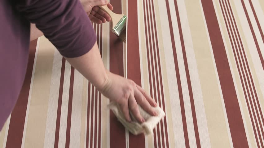 Male Hanging New Wallpaper On Stock Footage Video 100 Royalty Free 3683774 Shutterstock