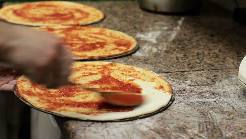 Chef Hand Making Italian Pizza.