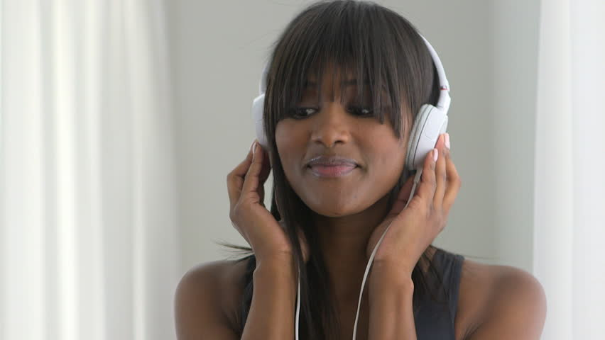 Black woman listening to music and dancing