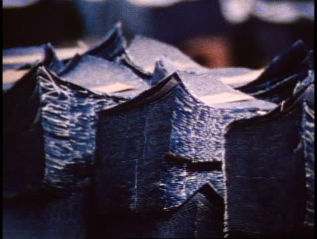 San Francisco, 1970's, close up, pan right, piles of cut denim in pieces