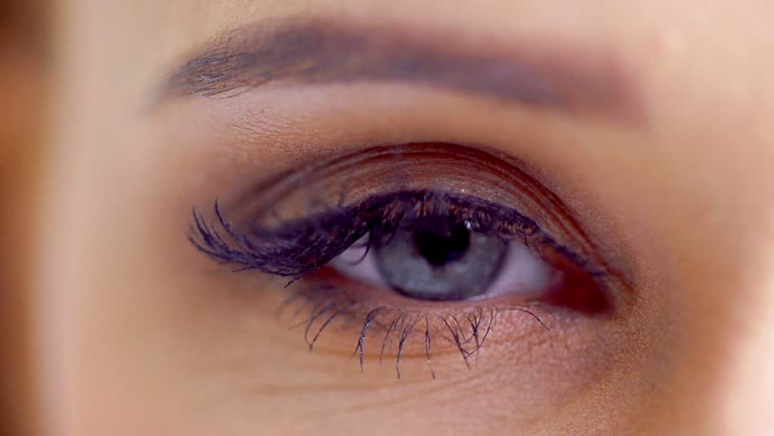 Close Up Shoot on Eye of Young Woman With Natural Makeup in Slow Motion