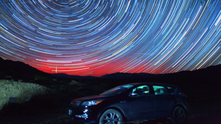 Amazing Night Desert Star Trails Over SUV Car Jeep in Death Valley, California. Includes an Aurora in the shot!
