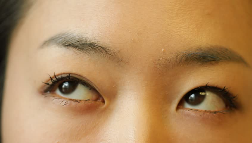Beautiful young Asian woman thinking and flickering eyes