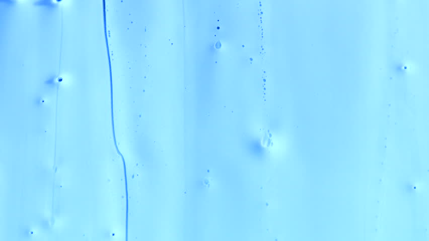 Pale blue viscous liquid flows down the screen, with bubbles and drips running