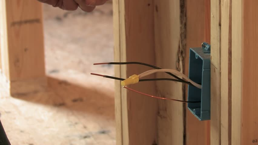 Stock video clip of electrician wiring wall outlet box in new stock video clip of electrician wiring wall outlet box in new shutterstock cheapraybanclubmaster Images
