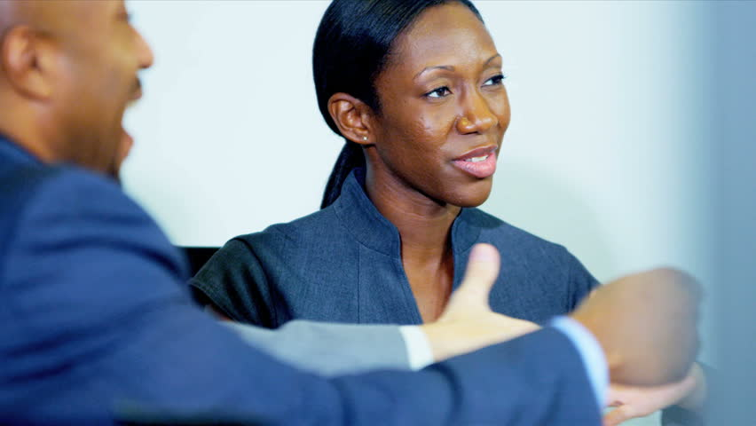 close up female ethnic team leader shaking hands with clients in meeting shot on red epic - Epic Consultant
