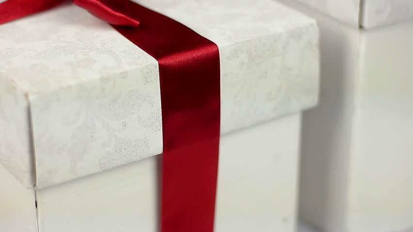 Applying sticker to gift box