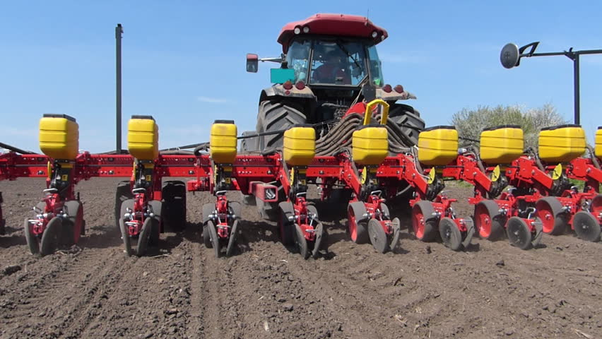 Tractor and Seeder Planting Crops on a Field | Shutterstock HD Video #3772484
