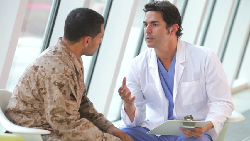 Doctor comforts soldier in uniform suffering from post traumatic stress disorder. Shot on Canon 5d Mk2 with a frame rate of 30fps